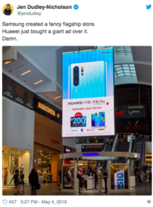 Huawei's digital billboard directly above Samsung's flagship store at Brisbane